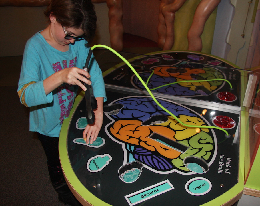 Child playing the Brain Operation Game.