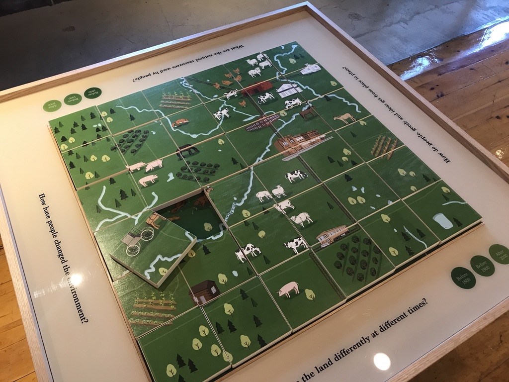 This puzzle table teaches about local natural, social and economic changes over time.
