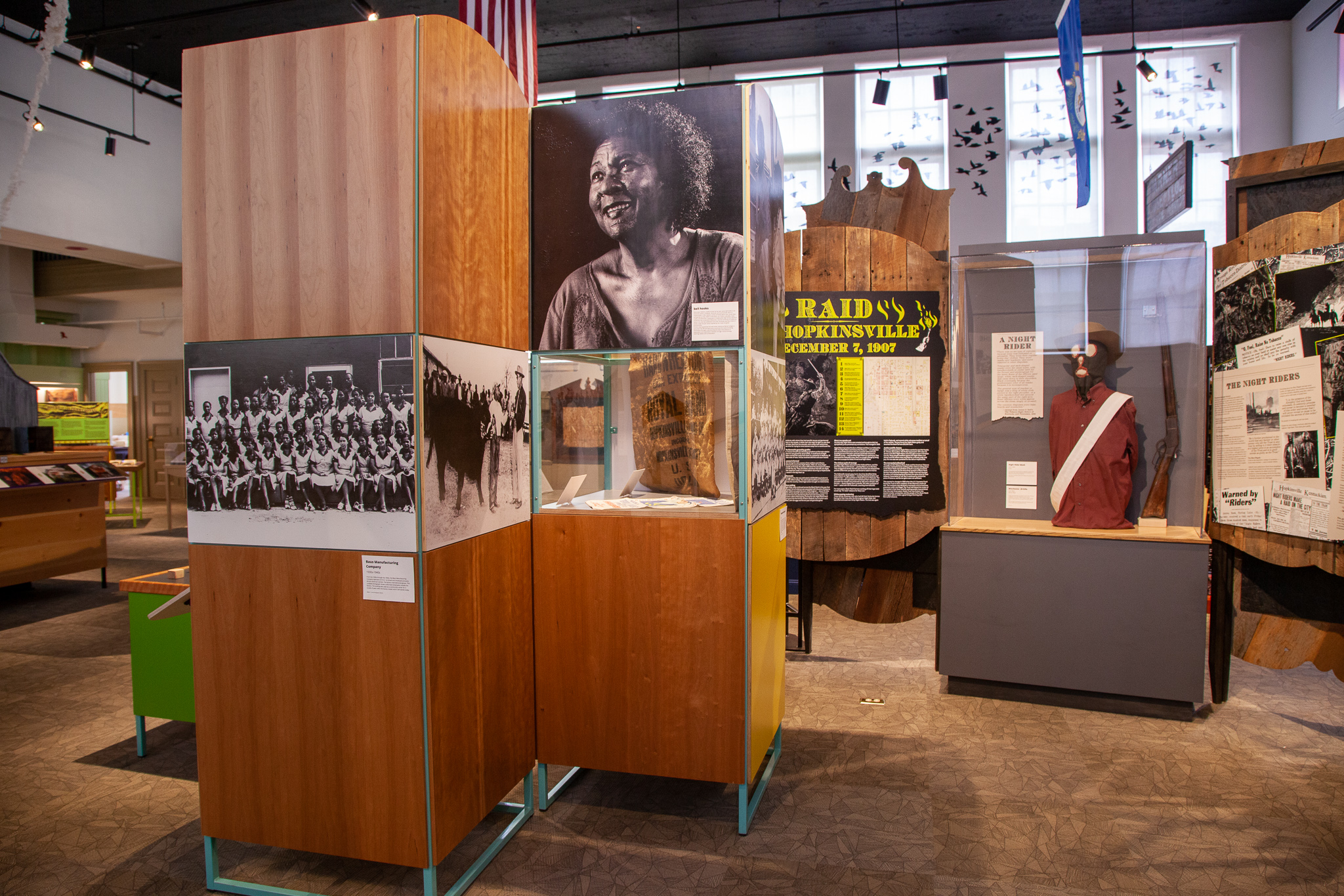 Hoptown History's exhibits show author bell hooks juxtaposed to The Night Rider & Black Patch War exhibits.