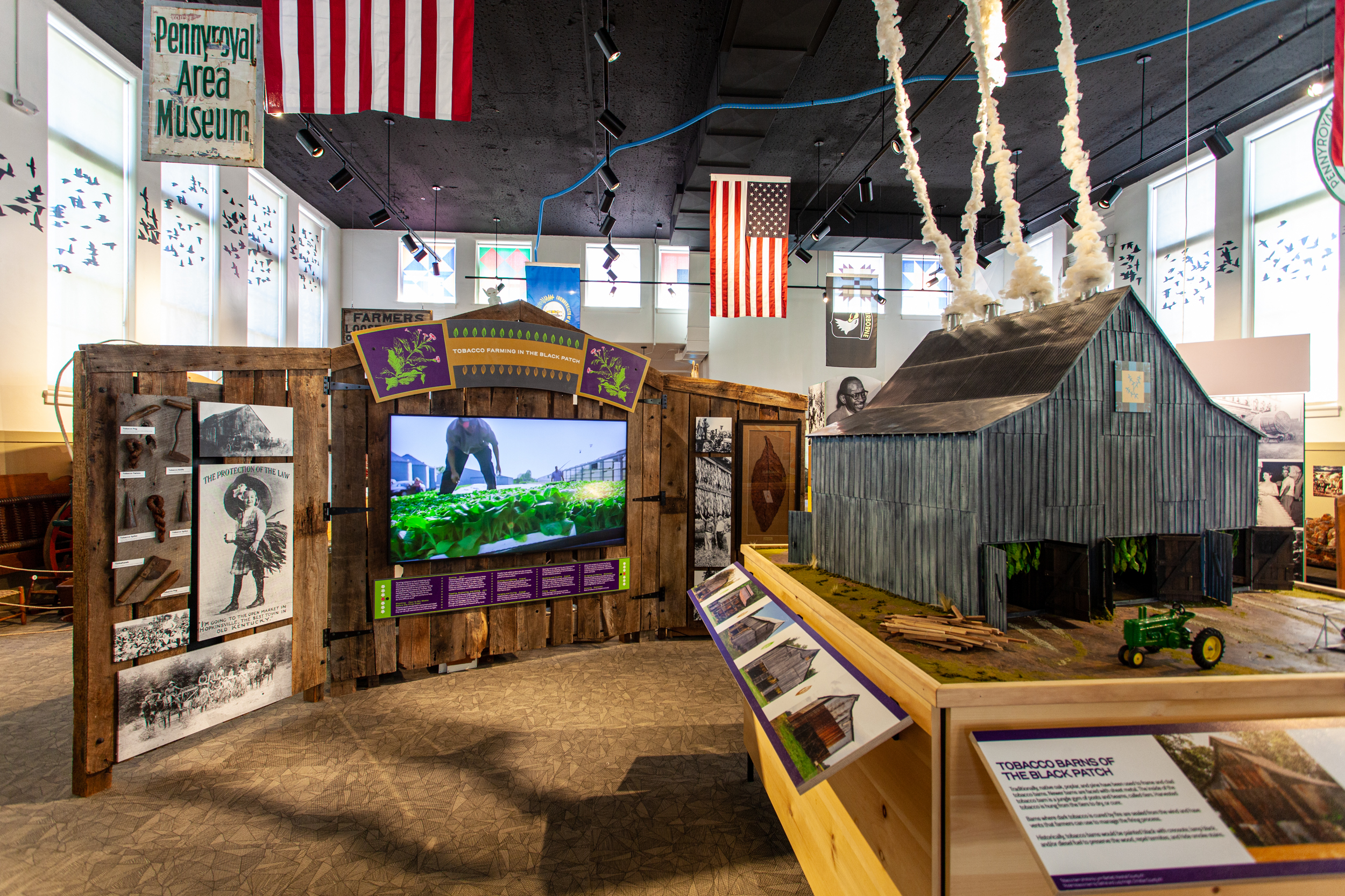 Farming in the Black Patch history and science exhibits, including a scale-model tobacco barn, at the inclusive and interactive Pennyroyal Area Museum.