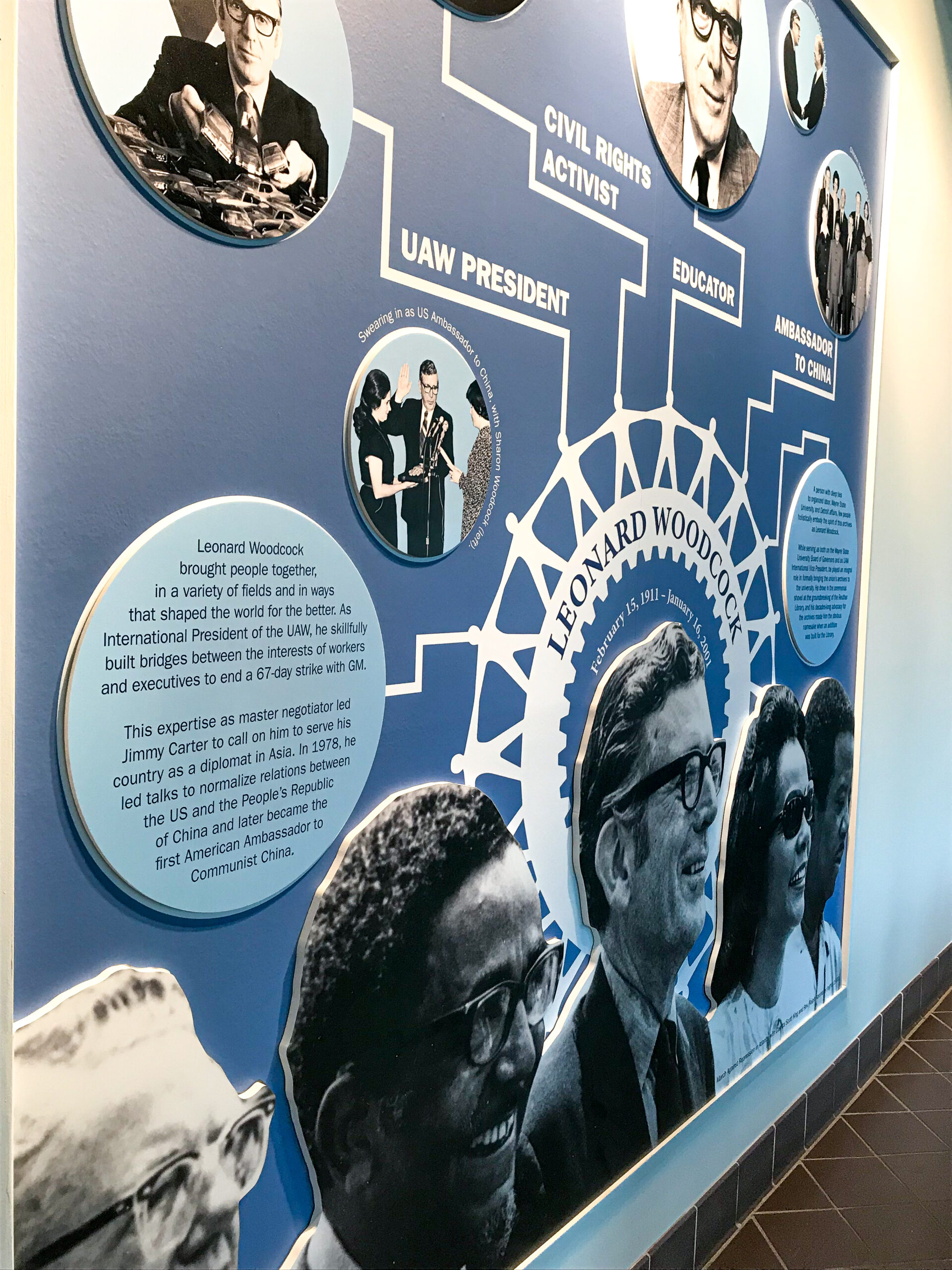 Side view showing the multimedia graphic elements of the Leonard Woodcock wall.