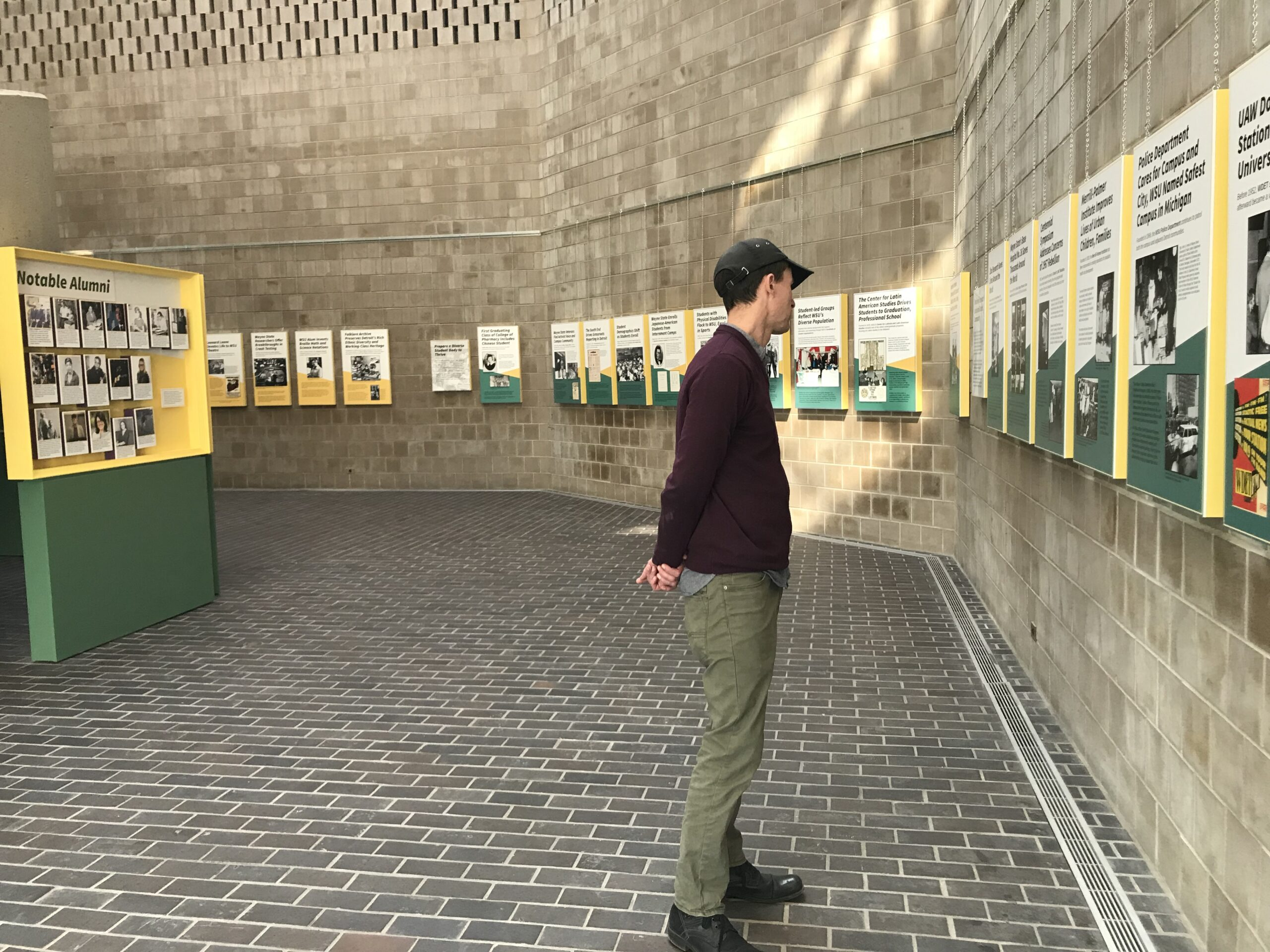 A visitor learns about Wayne State's history through a timeline of text, images and graphics.