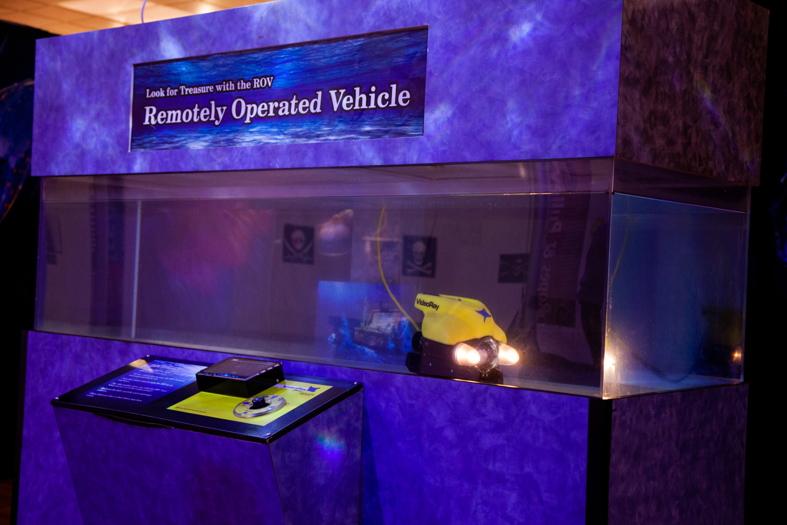 Search for treasure with the remote operated vehicle in the Treasure! exhibit.