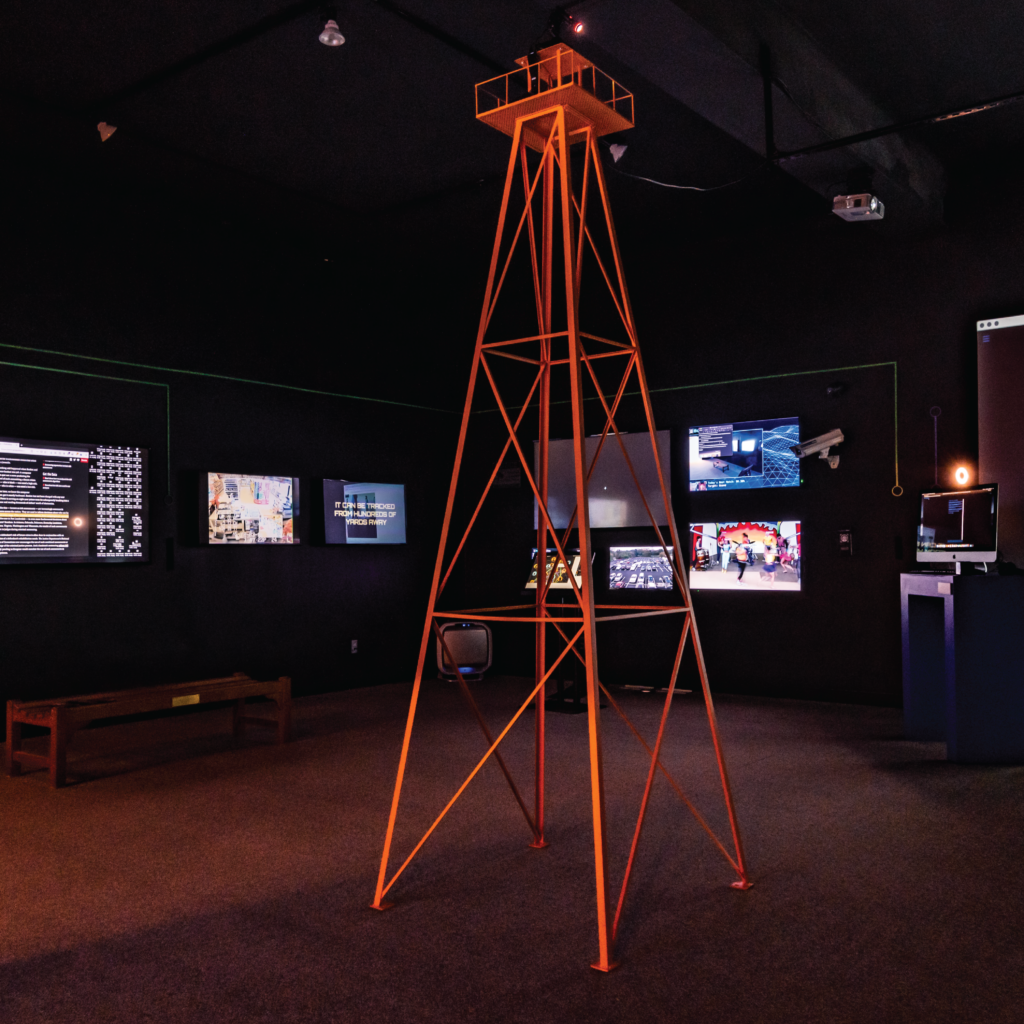 Tracked & Traced Exhibition watch tower. Flutter & Wow custom built and engineered this watchtower to flash a light around the room at a random location, always making the viewer feel tracked and traced.